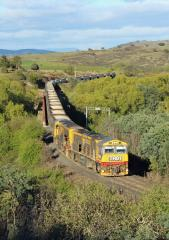 TR01-TR12 haul empty coal train 345 across the St Pauls River bridge at Avoca on 11 October. The usu