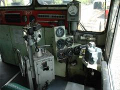 Drivers controls of ZA2117. To the left of the seat are the handbrake, direction and throttle contro