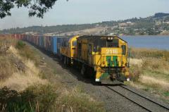 ZA2116 and an MKA skirt the Derwent River with a well loaded train bound for the Boyer paper mill, A