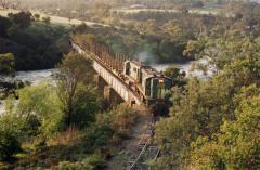 875 & 852 lead empty log train 5123 over the Derwent River near Hayes, October 1991