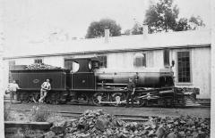An early photo of a C class locomotive. The location and specific details of the colour scheme are u