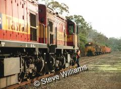 Loco 2011 on coal train 446, waits to cross train 443 with locos 2114-2118-2117 at Conara. July 2003