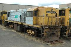 Having given up its bogies to keep the DQ class active, stored QR2056 sits on workshop bogies in the