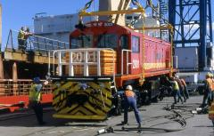 Staff make final adjustments to the alignment of DQ2001 before the loco is lowered further to be reu