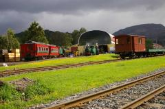 Various locomotives and wagons wait their next turn of duty outside the workshops in Queenstown, Dec