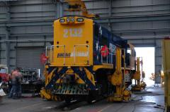 MKA2132 rests on jacks inside the workshops at East Tamar after minor derailment damage, December 20