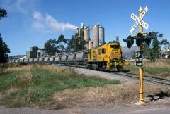 ZC11 leads the loaded cement train away from the loading silos at Railton, March 1994