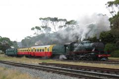 Locomotive M4 leads carriage SSD 2, AAL 11 and Suburban No.1 away from Coles Beach station on the Do